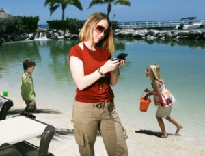 mom-ignoring-kids-on-waterfront