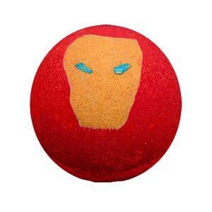 """Bright red round bath bomb with a shimmery gold boxy """"Face"""" of Iron Man's suit on the top. It has shimmery bright blue eye 'slits' painted on to resemble the glowing eyes of Iron Man's suit."""