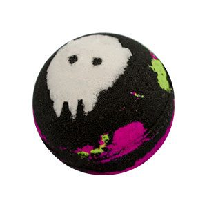 Round black bath bomb with splotches and stripes of neon pink and green. The top has a white skull like shape.