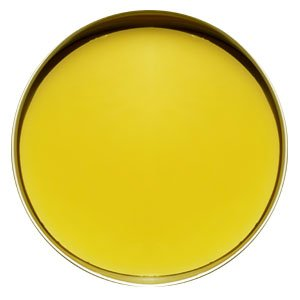 Top view of a round silver tin filled with a smooth bright yellow lotion bar.