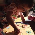 child doing puzzles