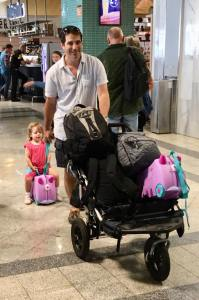 buggy full of bags and dad pulling child behind