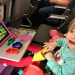 child playing with play dough on the airplane