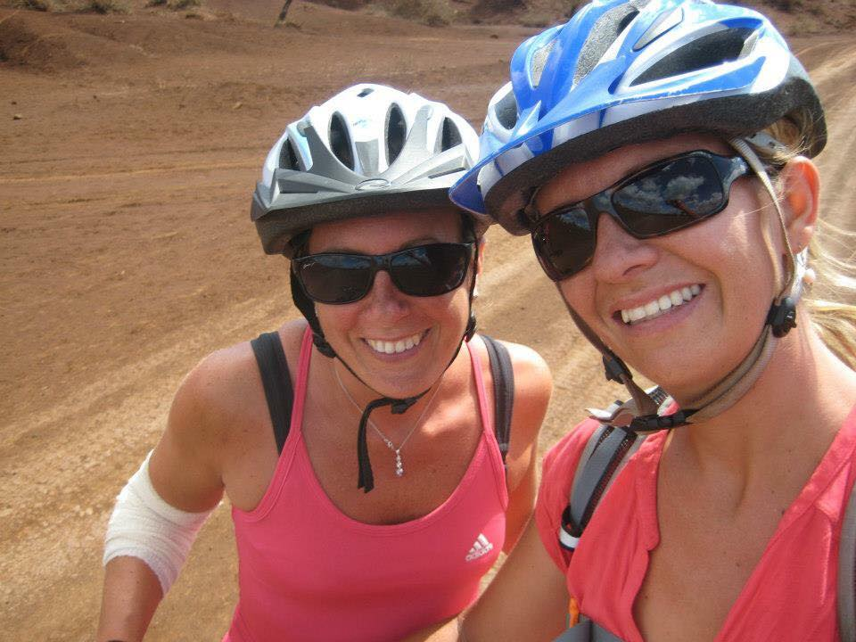 friends cycling together in Kenya