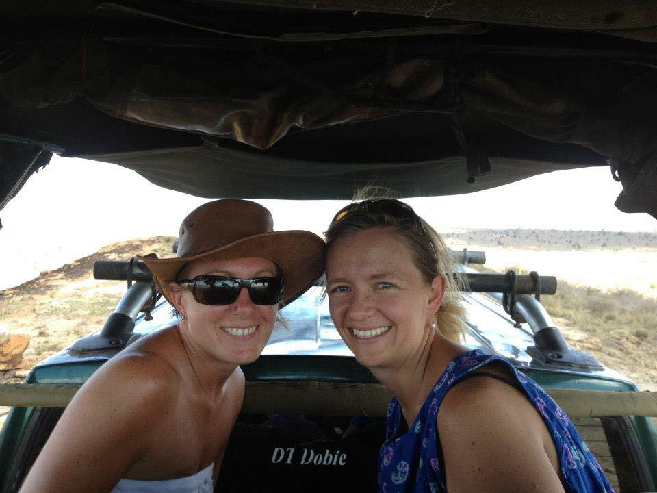 two friends sitting in a safari jeep in Kenya