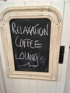 The relaxation lounge at The Dandelion Hideaway. Fitted out with leather sofas, rugs and warm coffee