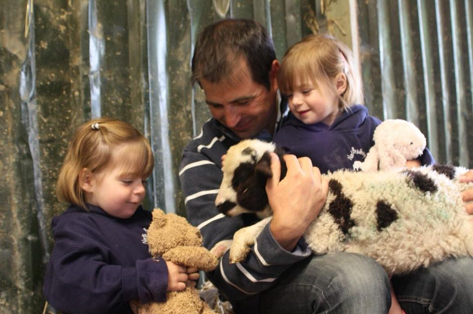 The Popitha Twins are helping Farmer Chris feed and cuddle the lambs