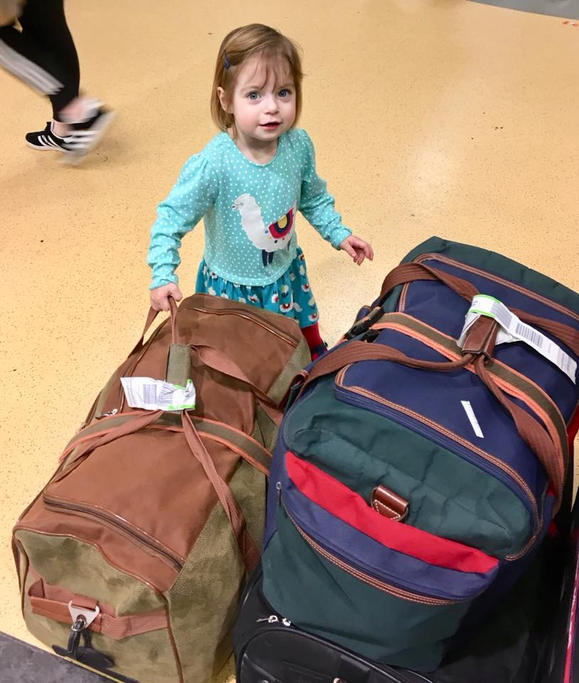 Young toddler with holiday bags