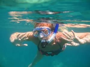 Lady snorkelling in the maldives