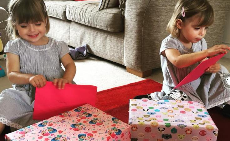 Twins, Poppy and Tabitha unwrapping their third birthday presents