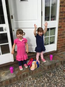 Vital non spill cups with twins standing on the door step