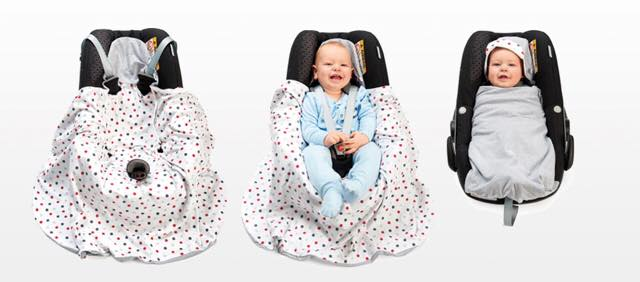 Morrck blanket in a car seat with baby. The perfect product for a mummy at a baby shower.