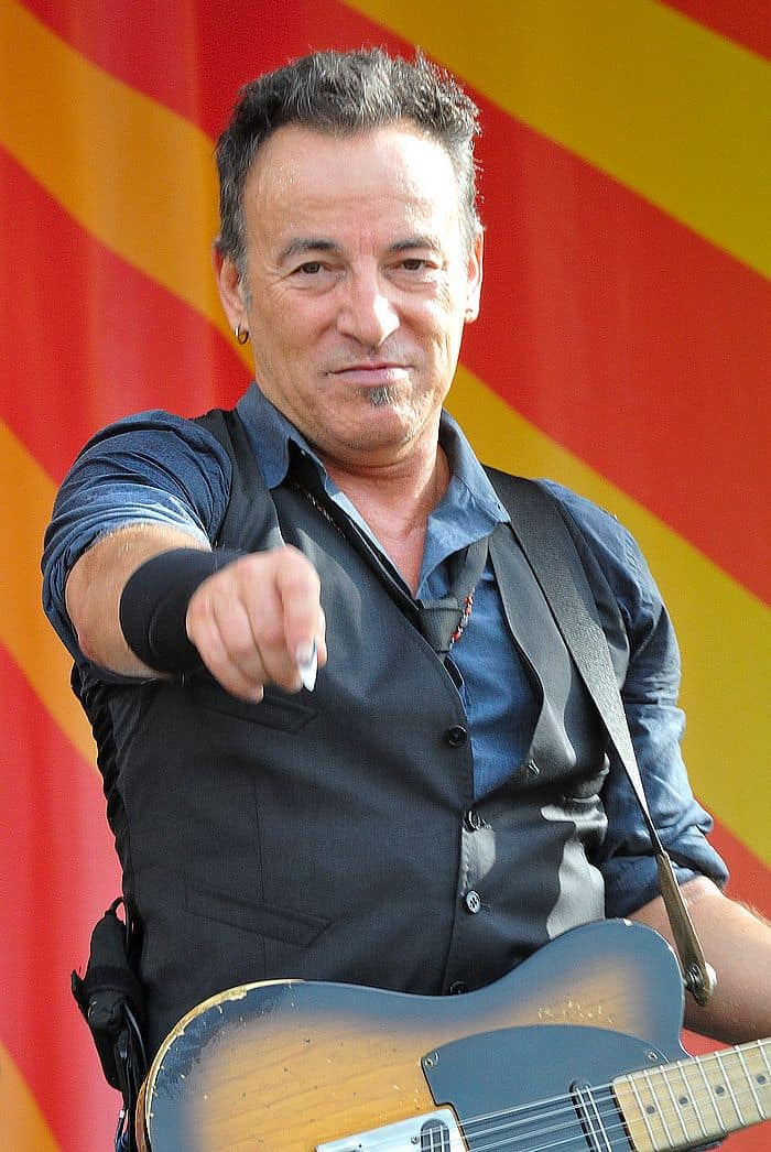 """<a href=""""https://www.flickr.com/people/75972766@N02"""">Takahiro Kyono</a> from Tokyo, Japan, <a href=""""https://commons.wikimedia.org/wiki/File:Bruce_Springsteen_(7479335544).jpg"""">Bruce Springsteen (7479335544)</a>, <a href=""""https://creativecommons.org/licenses/by/2.0/legalcode"""">CC BY 2.0</a>"""