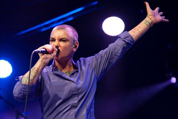 "<a href=""https://www.flickr.com/people/97355030@N00"">Bryan Ledgard</a>, <a href=""https://commons.wikimedia.org/wiki/File:Sinead_O'Connor_(14645054609).jpg"">Sinead O'Connor (14645054609)</a>, <a href=""https://creativecommons.org/licenses/by/2.0/legalcode"">CC BY 2.0</a>"