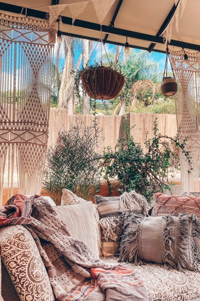 Cozy Fall Outdoor Rooms with plants and curtains | Poplolly co