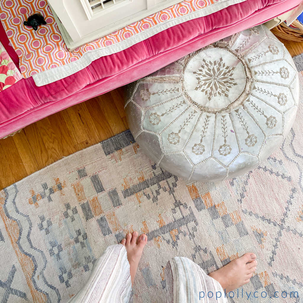 silver metallic pouf with pink kilim boho rug from world market