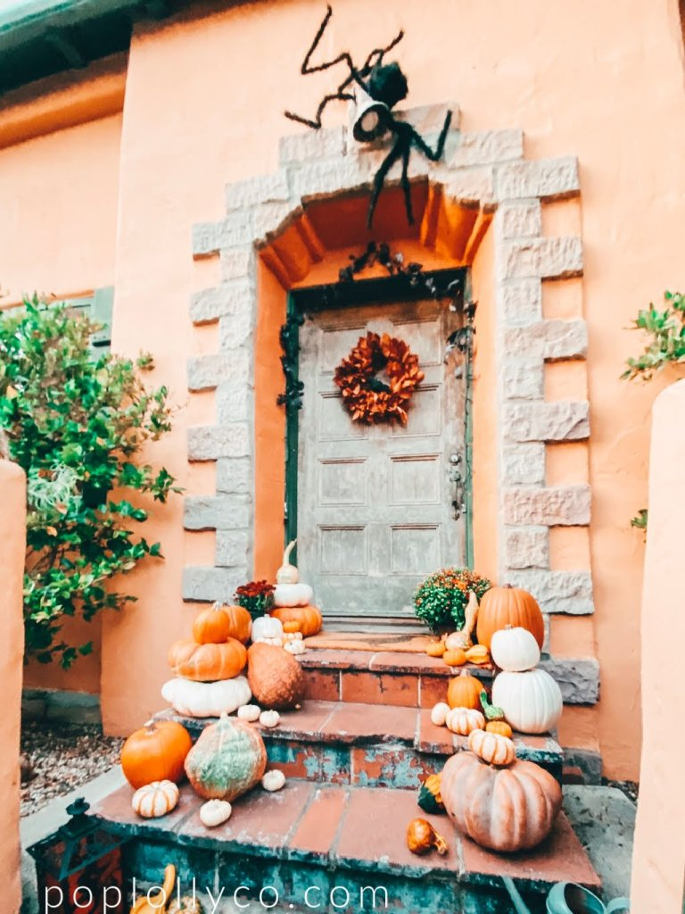 Spanish home covered in giant spiders for Halloween | #halloweendecorationsoutdoor #halloweenfrontporchdecor #halloweenhouse #halloweenprojects #halloweenyarddecorations | Poplolly co