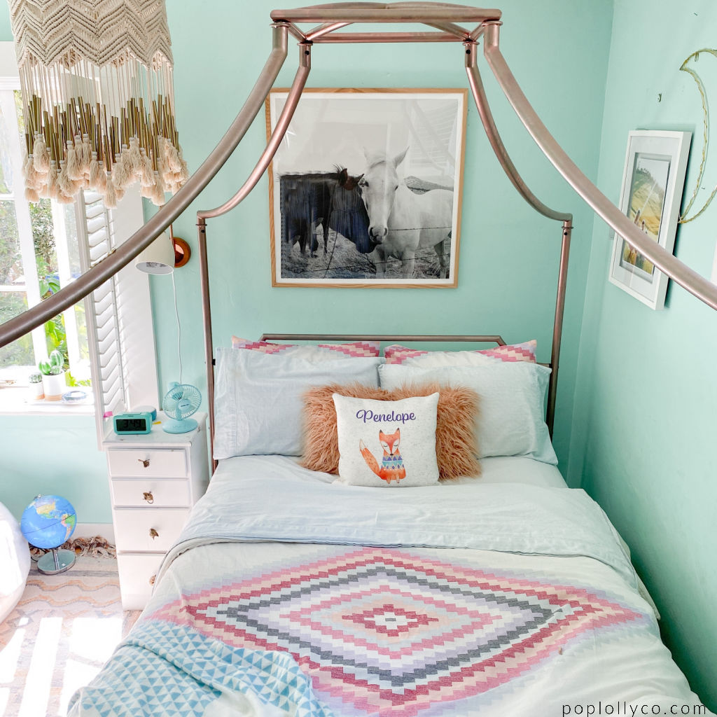 rose gold canopy bed | macrame chandelier | black white horse photography | turquoise walls | girls boho room | tween girls bedroom | #urbanoutfitters #anthropologie #cupcakesandcashmere | Poplolly co