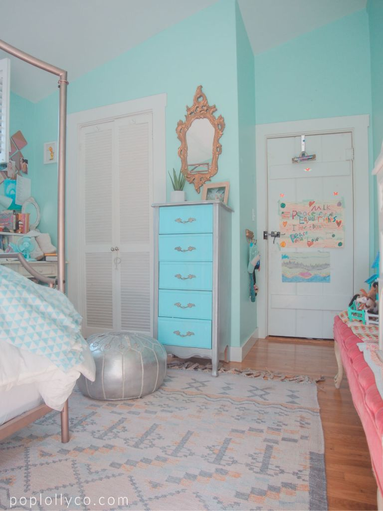 brass vintage mirror with turquoise metallic dresser and a silver metallic pouf and world market pink kilim rug for a bright boho girls bedroom   Poplolly co