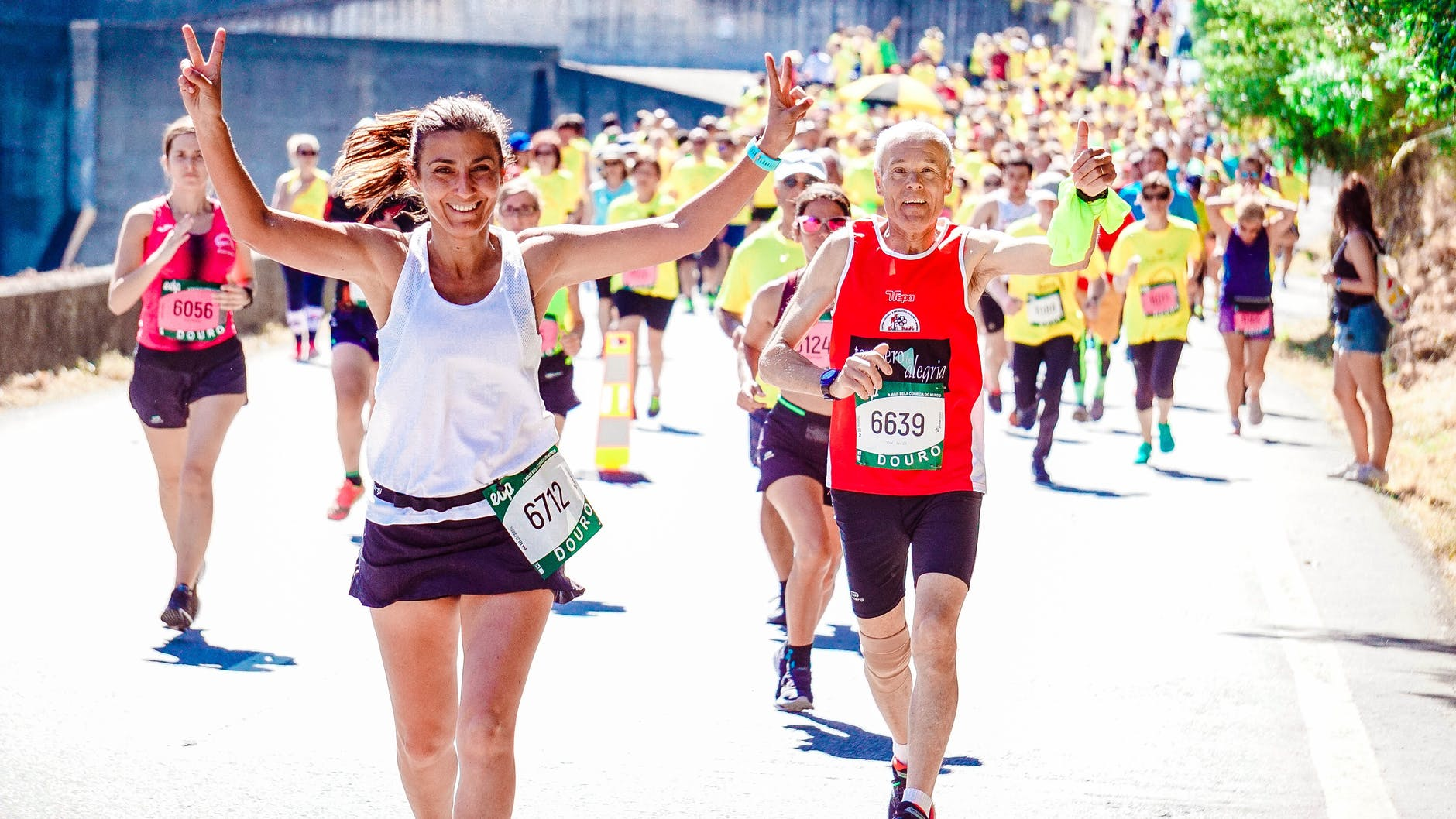 female and male runners on a marathon