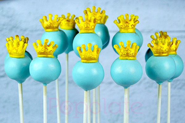 Blue cake pop with gold tiara