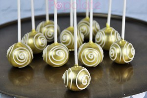 Gold cake pops with swirls