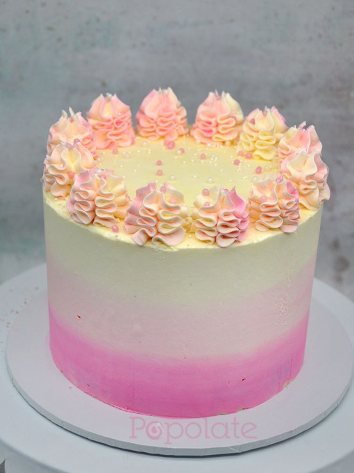 Pink and white buttercream cake