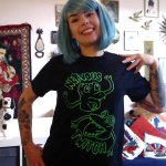 Erin Hyde of Nervous Twitch modelling the band's own merch
