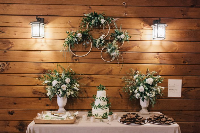 Wedding cake display with floral hoops