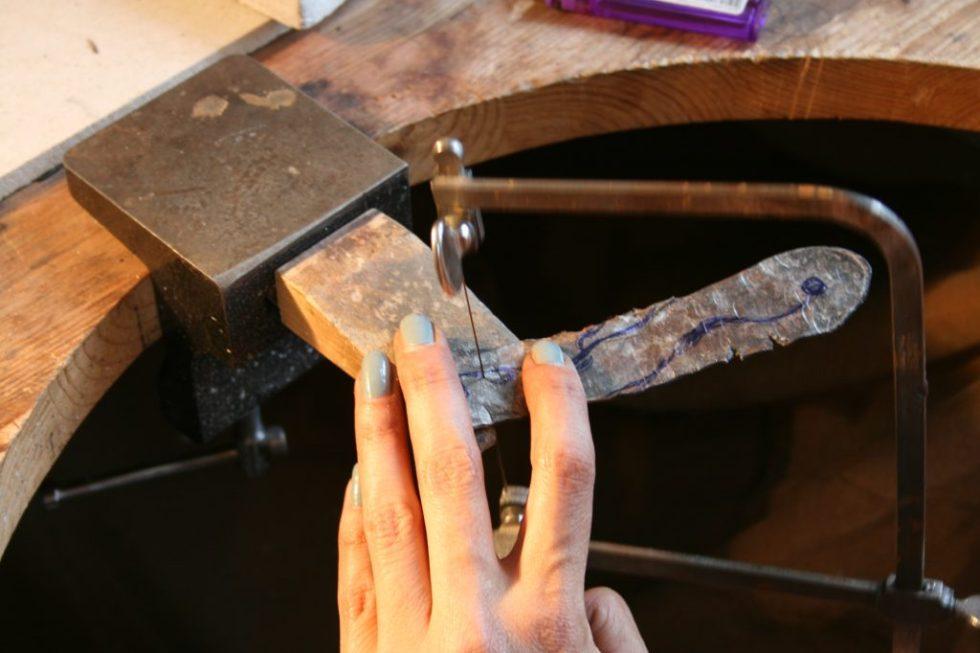 Piercing out the flat shape with a jeweller's sawPiecing out the flat shape