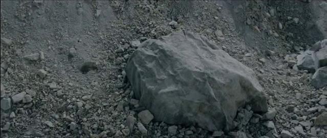 Frodo beneath his cloak