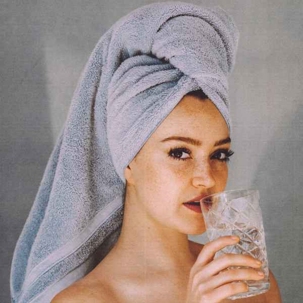 woman with glass of water after shower