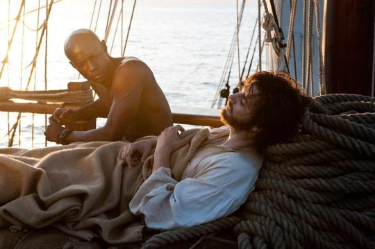 Adam Ewing (Jim Sturgess), a dying American lawyer sympathetic to Autua's (David Gyasi) slavery plight in 1850. Credit: Warner Bros. Pictures