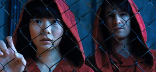 Sonmi-451 (Doona Bae) and Hae-Joo Chang (Jim Sturgess) discover the truth about Unanimity. Credit: Warner Bros. Pictures