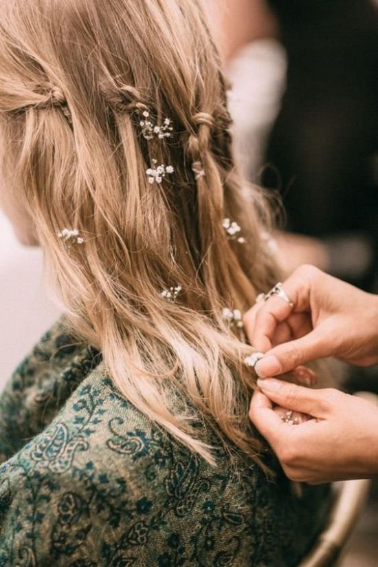 wedding hairstyle with white tiny flowers