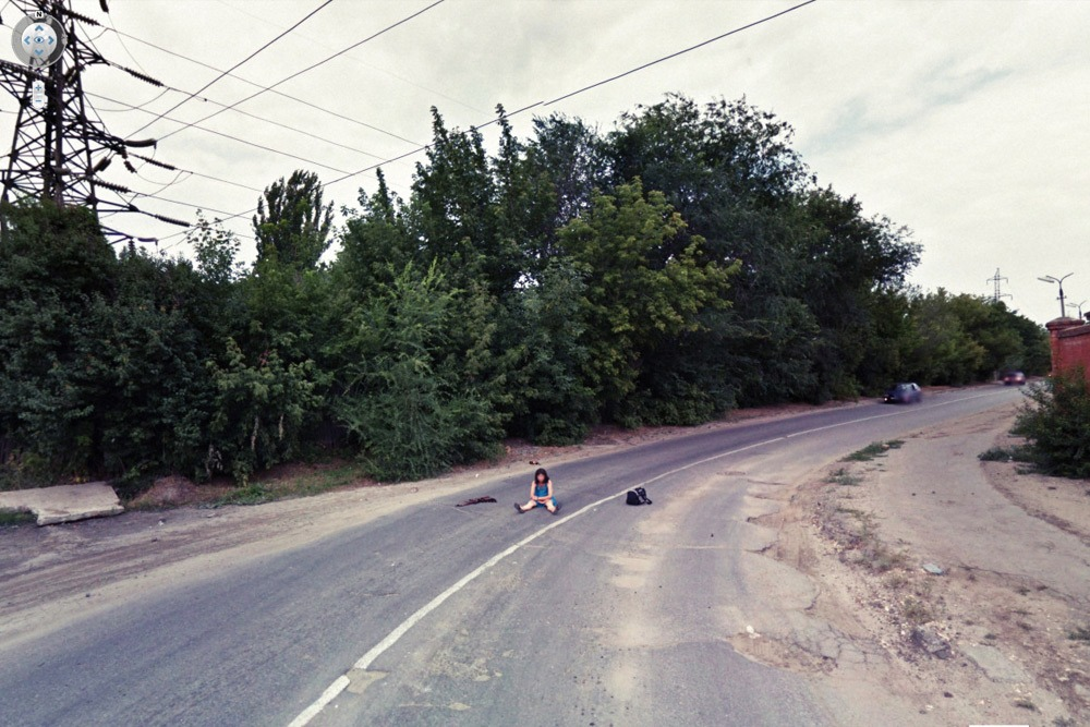 15 Crazy Moments Captured on Google Street View - Girl Sitting in Middle of Street