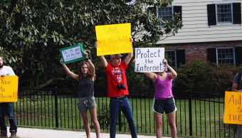 Some of Ajit Pai neighbors came out and joined the protest in his neighborhood. May 14, 2017. Photo by Eleanor Goldfield.