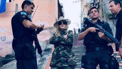 Foto de Em dia de tiroteio, Madonna circula pelo Morro da Providência