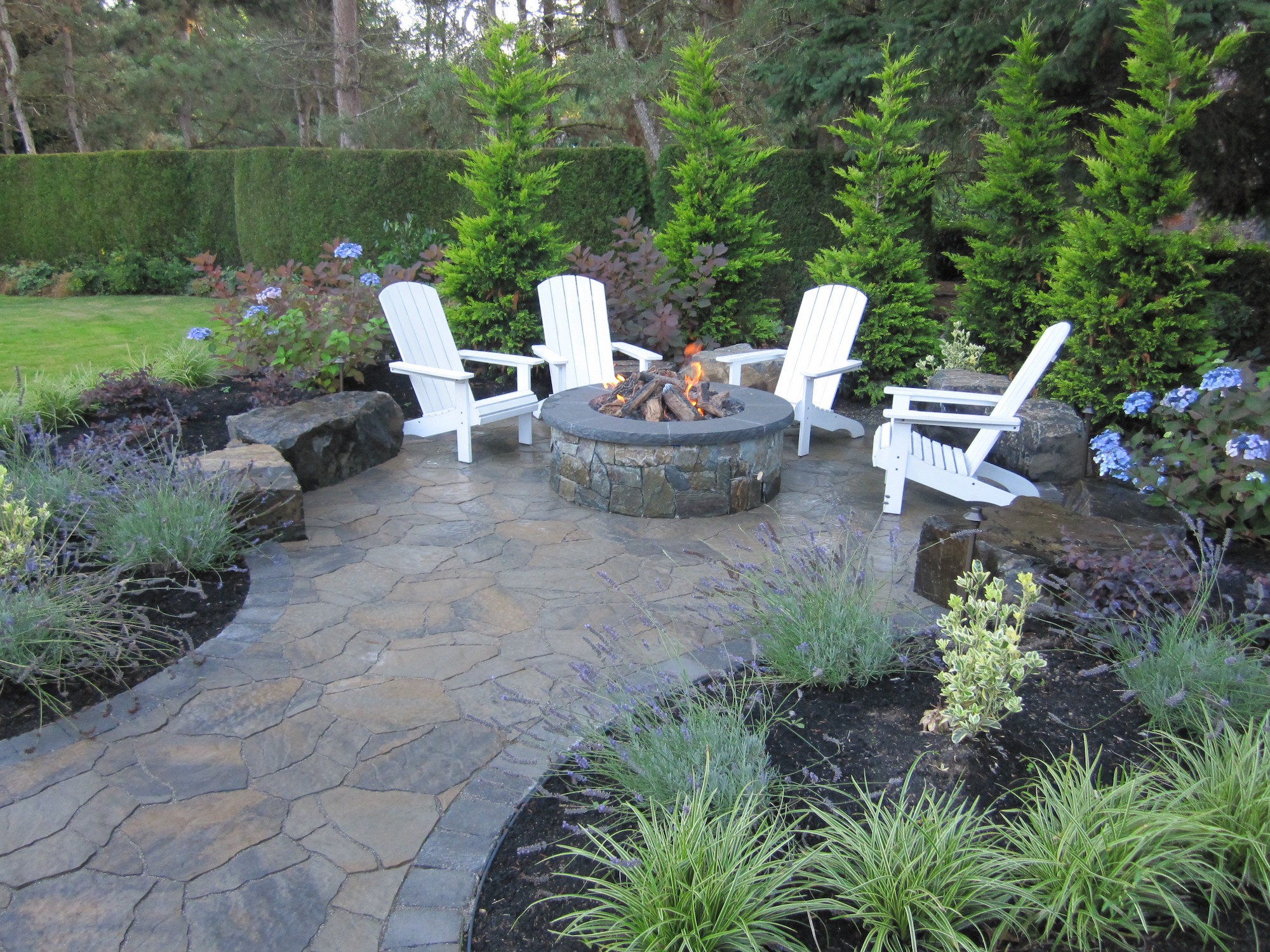15 Fire Pit Ideas To Keep You Cozy Year Round on Garden Ideas With Fire Pit id=36850
