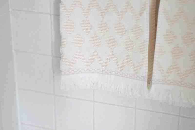 Refresh your master bathroom by switching out towels and accessories. These beautiful pink tiles completely finish this space.