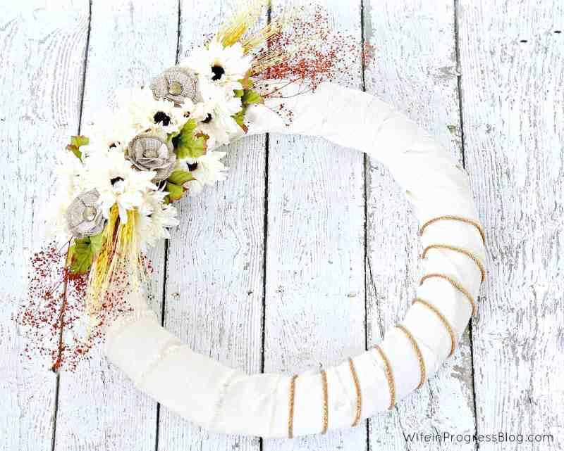 This beautiful fall wreath is so simple to make and looks beautiful when finished. Have you ever wanted to know how to make a burlap wreath? Then this tutorial is for you! With step by step pictures, you'll recreate this wreath in no time.