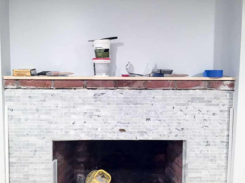 basement-reno-week-3-marble-fireplace-2