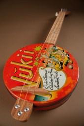 Nukii cookie tin guitar by Diane Sutliff