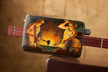 Kimmer Olesak's cookie tin guitar with silkscreened graphics