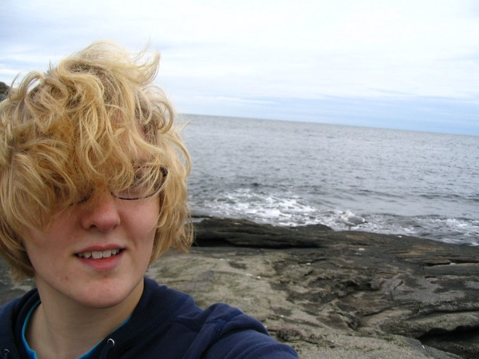 I took a selfie with the Atlantic Ocean behind me. The wind threw my hair over my face for the photo.