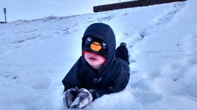 Oldest Son, sledding like a penguin.