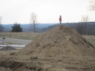 "This is my older son, demonstrating that he is the ""King of the Mountain."""