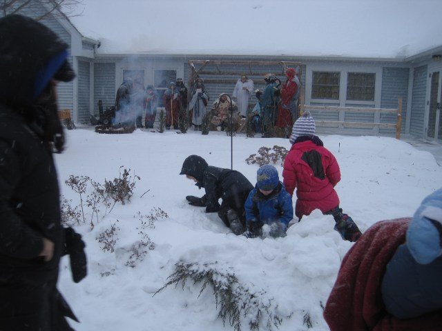 This is what happens when you take your kids to the outdoor nativity service on Christmas eve during a blizzard. They build a snowfort.