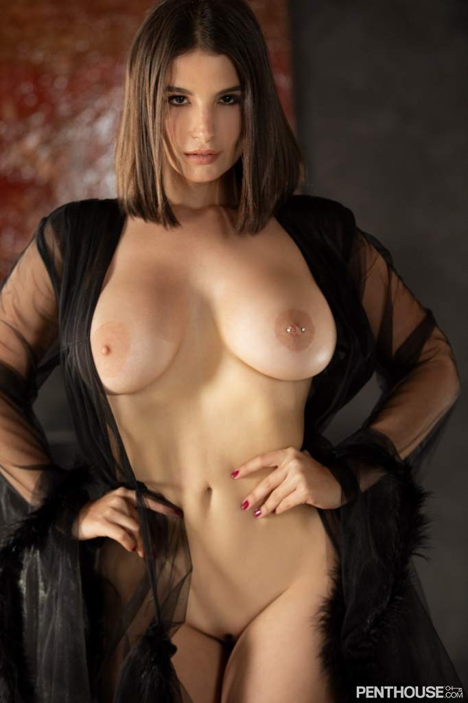 LaSirena69 stripping nude out of lingerie in her February 2021 Penthouse Pet Of The Month photo spread 007