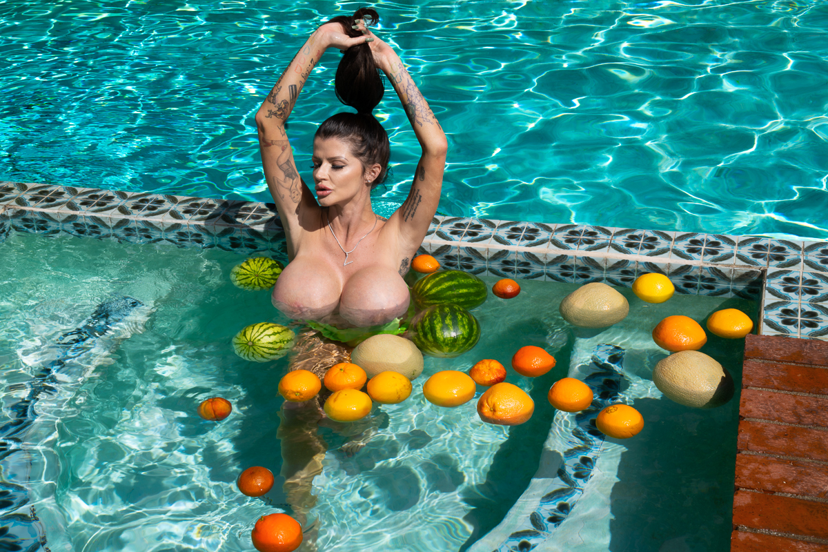big-boobs with fruit by a pool